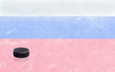 Hockey Stick and Puck with Russian Flag on Ice