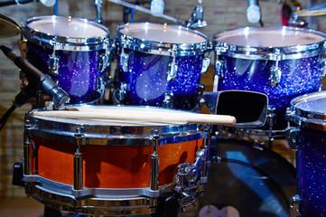 Drums set and sticks, close-up, selective focus