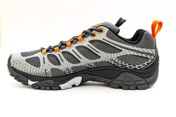Brand new men's gray trail shoe isolated on white background.