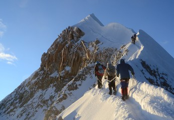 Team of three Mountaineers push the last bit to the spectacular summit of Huayna Potosi.