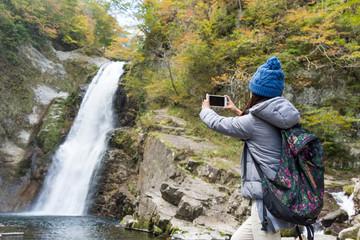 Woman taking photo when hiking