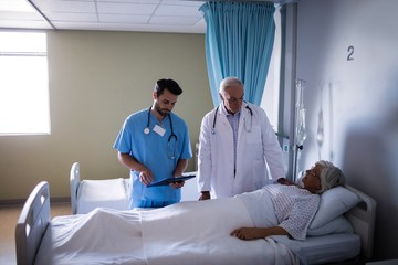 Doctor examining senior patient in the ward