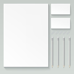 realistic branding mock up, isolated on white background with sheets of paper, business cards, pencils and paper clips