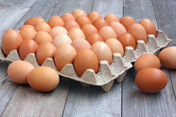fresh chicken brown eggs in packing