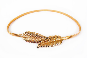Women's gold belt is isolated on a white background