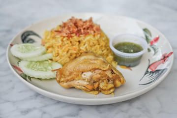 Muslim yellow rice with chicken,(Thai-Muslim version of Indian , with fragrant yellow rice. It's usually eaten with chicken)
