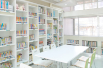 blurred bookshelf in library room for background