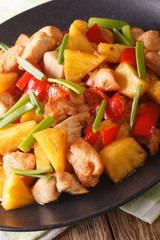 fried chicken with pineapple in sweet and sour sauce close-up. Vertical
