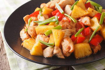Chinese food: fried chicken with pineapple in sweet and sour sauce close-up. horizontal