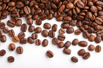 roasted coffee beans isolated in white background. Roasted coffee beans background close up. Coffee beans pile from top on white background with copy space for text. Good morning.