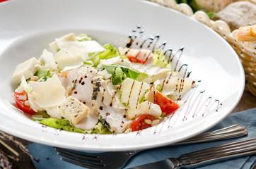 Caesar salad with fried chicken breast
