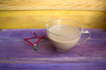 coffee with cream and red string bracelet