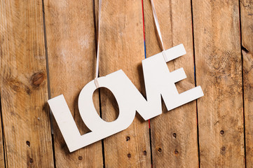 Wooden letters forming word LOVE written on wooden background