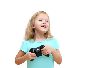 little girl holding a gamepad isolated on white background