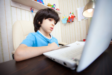 child with computer, distance learning