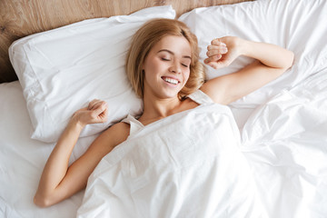 Top view of woman waking up after sleep