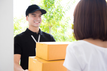 Delivery man deliver packages to a woman