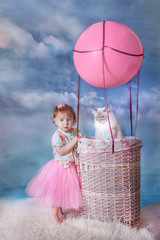 Girl and cat with balloon