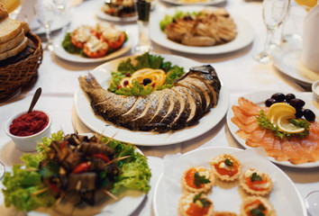 Festive table with fish and other specialties