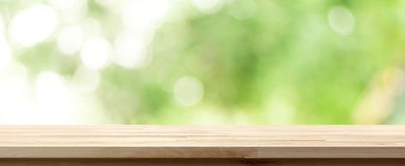 Wood table top on natural bokeh green background, panoramic banner