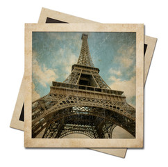 Vintage instant photo paper frames with Eiffel tower shot isolated