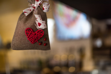 Decorative bag with the image of the heart made with hands Valentine's Day