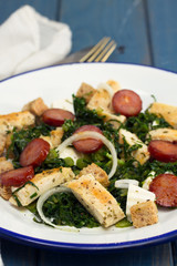 salad with grilled chicken and smoked sausage on plate