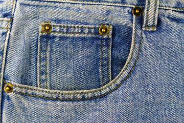 Front pocket of blue jeans, denim texture background
