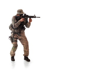 man in military outfit of the American trooper in modern times on a white background in studio