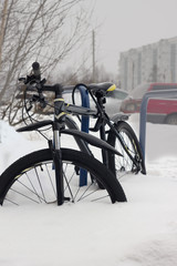 mountain bike parked in the snow