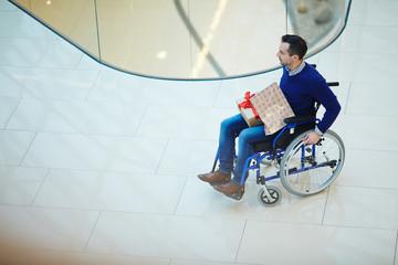 Man in wheelchair shopping alone