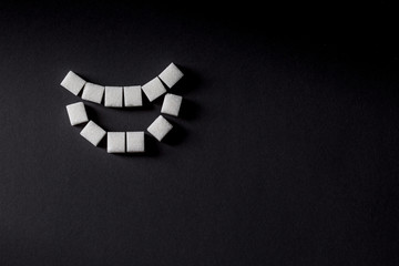 crooked teeth from sugar cubes forming smiley