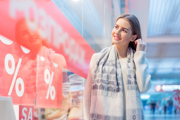 Sales concept. portrait of a young beautiful woman smiling