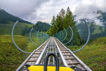 Recreation with alpine coaster in Alps, Tirol, Austria