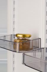 Jar of honey on the fridge door