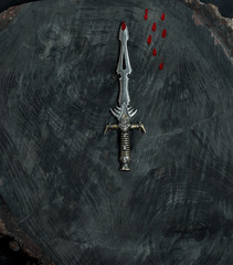 ritual knife on a black wooden background