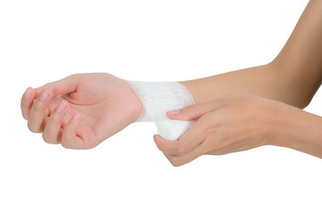 woman bandaging  and first aid her wrist in pain area, Isolated on white background.