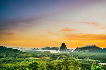 Landscape Viewpoint Phang Nga Bay highlight of Phang nga ,Thailand,Silhouette Phang nga bay lanscape with mangrove forest in the early morning before sunrise.