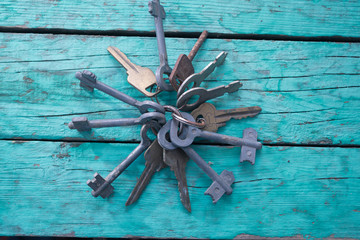 Old keys on a green background