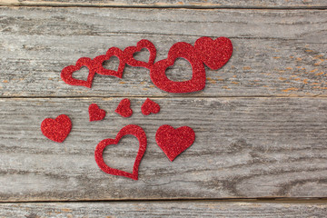 red heart shapes on a rustic wood background