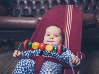 Baby sitting in a bouncy chair
