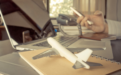 Travel agency using phone in office working desk