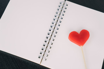 Valentines Red heart on blank notebook diary