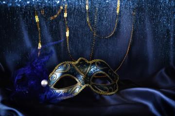 elegant venetian mask on blue silk background