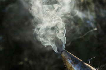 Close-up of smoke emitting from bee smoker used in apiculture