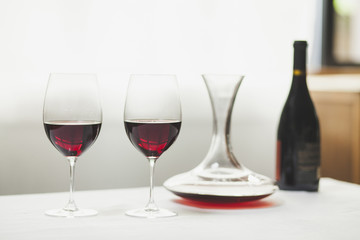 Close-up of red wine with decanter and bottle on table
