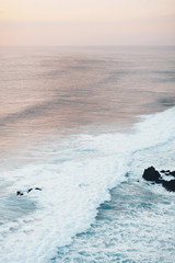 High angle view of waves in sea against sky