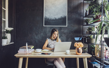 Businesswoman working with laptop computer at home office