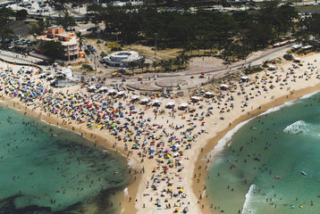 Aerial view of people enjoying at beach in city
