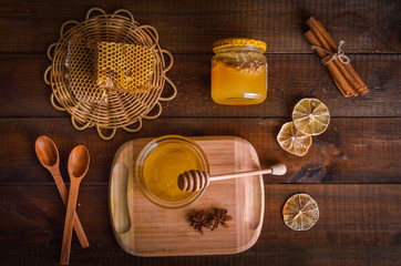 Honey on a wooden background